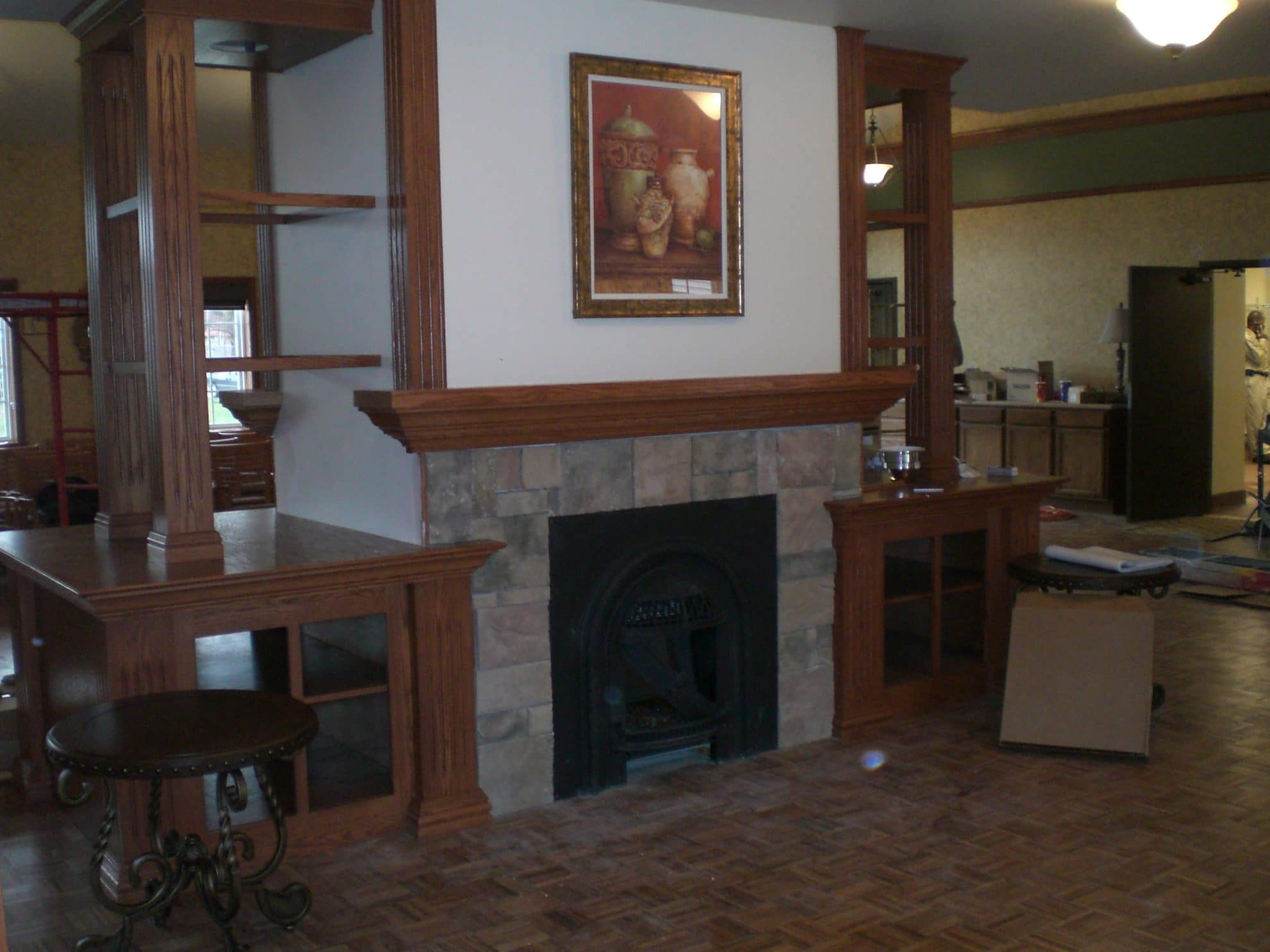 Fireplace and bookcases.