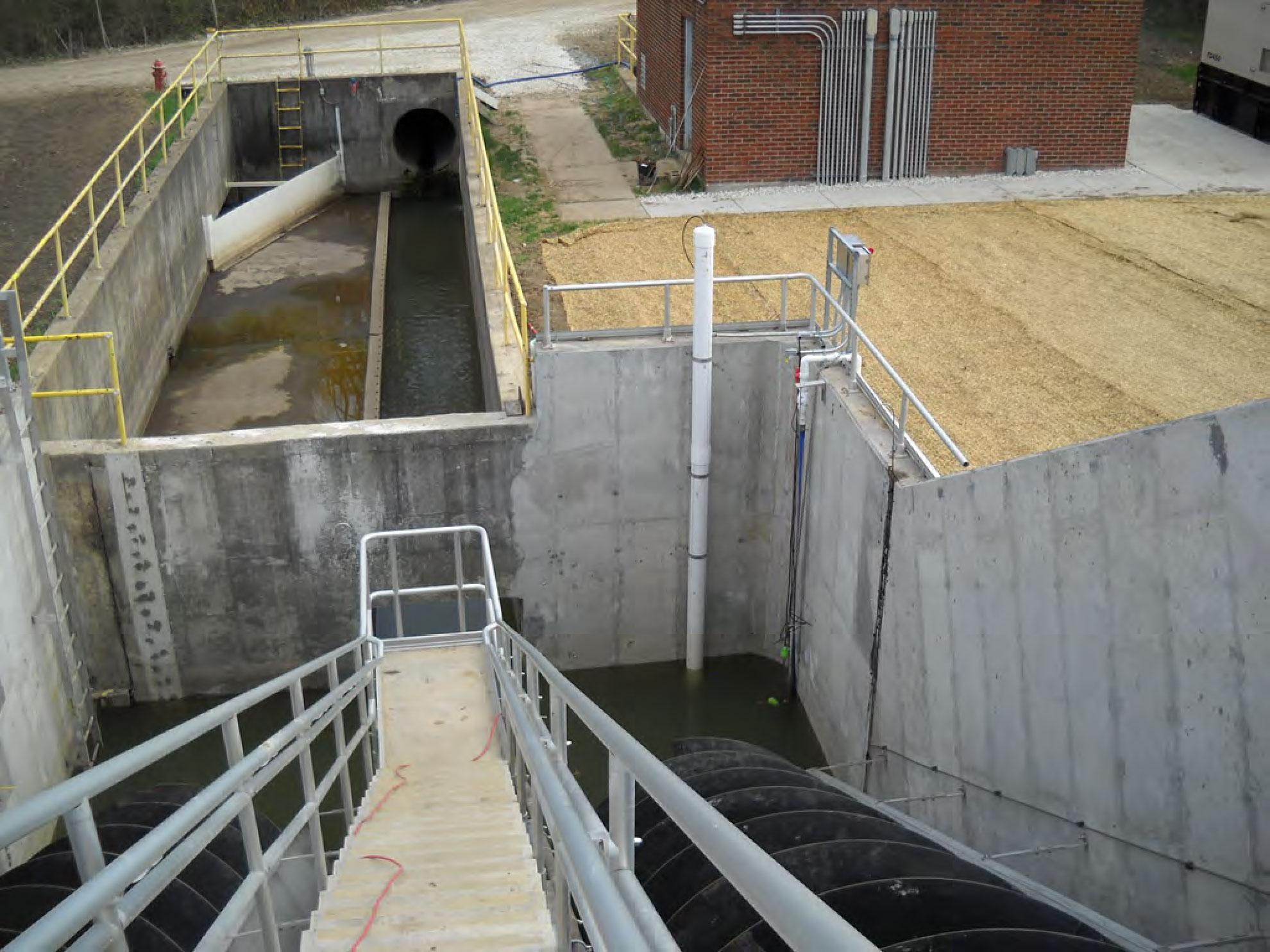 Concrete walk into water area.